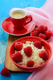 Fresh raspberries on the curd and coffee Royalty Free Stock Photography