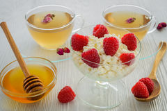 Fresh raspberries on the curd and honey Stock Images