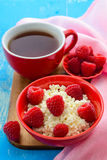 Fresh raspberries on the curd and tea Royalty Free Stock Images