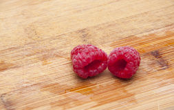 Fresh Raspberries on a Cutting Board. Isolated on White with a Clipping Path Stock Photography