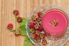 Fresh raspberries drink, wooden background Royalty Free Stock Photo