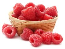 Fresh Raspberries. In a wooden basket over white background Royalty Free Stock Images