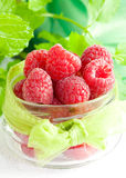Fresh raspberries in a glass. With ribbon Stock Image