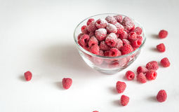 Fresh raspberries in the glass bowl. On the white background Stock Photo