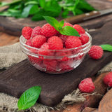 Fresh raspberries. In a glass bowl on a wooden table. Copy space. A eye level Closeup Stock Images