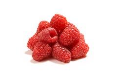 Fresh raspberries isolated. A heap of fresh raspberries on white isolated - all sharp Stock Photo