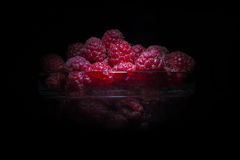 Fresh raspberries isolated on black background Stock Image