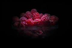 Fresh raspberries isolated on black background. Fresh raspberries isolated on black bg textured Stock Image
