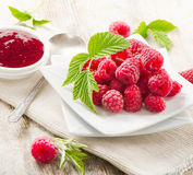 Fresh raspberries . Fresh raspberries and jam .Selective focus Royalty Free Stock Photography