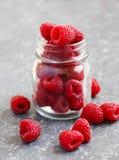 Fresh raspberries in jar. On stone background Royalty Free Stock Photos