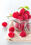 Fresh raspberries. In a jar on the table close-up Stock Photography