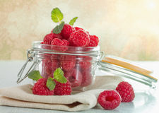 Fresh raspberries. In a jar on the table close-up Stock Photos