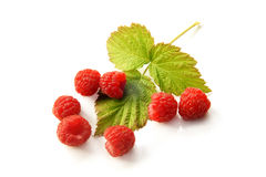 Fresh raspberries with leaf. On a white background Royalty Free Stock Photo