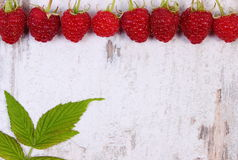 Fresh raspberries with leaf and copy space for text on old wooden background Stock Images