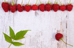 Fresh raspberries with leaf and copy space for text on old wooden background Stock Image