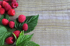 Fresh raspberries with leaves as background. Top view Stock Image