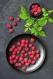 Fresh raspberries with leaves. On  dark concrete  background, top view Royalty Free Stock Images