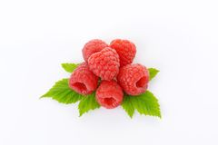 Fresh raspberries. With leaves on white background Stock Photography