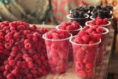 Fresh raspberries at market,. Closeup Stock Images