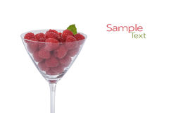 Fresh Raspberries. A Martini Glass Filled with Fresh Ripe Raspberries Isolated on a White Background.Copy Space Royalty Free Stock Image