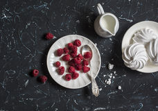 Fresh raspberries and meringue. On a dark background Stock Images