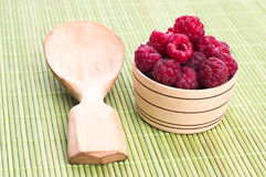 Fresh raspberries with mint in a bowl. On White wooden table Stock Photo