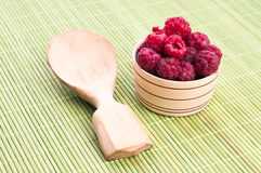 Fresh raspberries with mint in a bowl. On White wooden table Stock Images