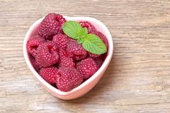 Fresh raspberries with mint stock image