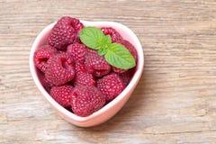 Fresh raspberries with mint stock image