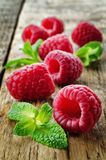 Fresh raspberries with mint. On a wood background. toning. selective focus Stock Photos