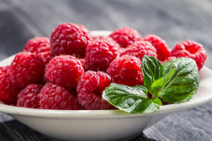 Fresh raspberries with mint leaf Stock Photos
