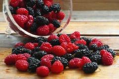 Fresh raspberries and mulberries Stock Photo