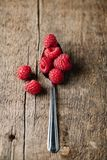Fresh raspberries on natural rustic wooden board. Fresh ripe raspberries on natural rustic wooden board Stock Image