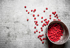 Fresh raspberries in the old pot. On a stone background Royalty Free Stock Photos