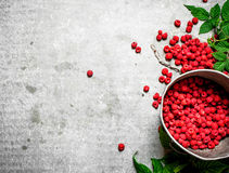 Fresh raspberries in the old pot. On a stone background Stock Photography