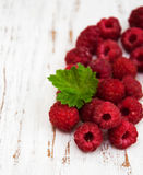 Fresh  raspberries. Fresh raspberries on a old wooden background Royalty Free Stock Photo
