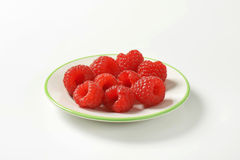 Fresh raspberries. On a plate Royalty Free Stock Photo