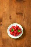 Fresh raspberries. On a plate Stock Photo