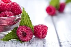 Fresh Raspberries. Portion of fresh Raspberries on wooden background Royalty Free Stock Photos