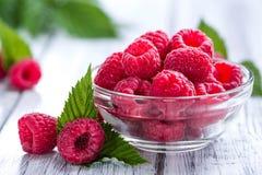 Fresh Raspberries. Portion of fresh Raspberries on wooden background Stock Photography