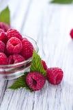Fresh Raspberries. Portion of fresh Raspberries on wooden background Royalty Free Stock Photo