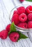 Fresh Raspberries. Portion of fresh Raspberries on wooden background Stock Photos