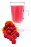 Fresh raspberries pouring out of yellow bowl and fresh cocktail. Of raspberries, fresh milkshake. Isolated on white background Royalty Free Stock Photos