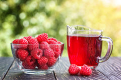 Fresh raspberries and raspberry juice. In summer Royalty Free Stock Images