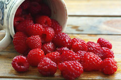 Fresh raspberries. Fresh red raspberries on a wooden table Royalty Free Stock Photos