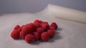 Fresh raspberries rotation in 4K. Fresh raspberries on the table. Camera`s rotate. Concept: footage for the recipe. Food stock footage