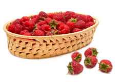 Fresh raspberries (rubus idaeus) in the basket. Isolated over white background Royalty Free Stock Photos