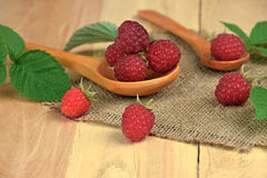 Fresh raspberries in a rural setting. Summer fruit. Ripe raspberries in a  wooden spoon. Healthy eating. Red raspberries Royalty Free Stock Photos