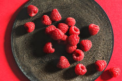 Fresh raspberries on rustic black plate Royalty Free Stock Images