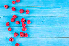 Fresh raspberries on a rustic wooden table Royalty Free Stock Image